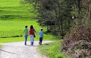 family on hiking trail at spring