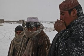 frozen afghan people in winter