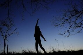 silhouette of a dancing girl at dusk