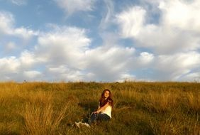 girl resting on the grass autumn meadow