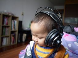 kid with big black headphones