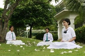 meditation of buddhist girls sitting on the background of temple in Thailand