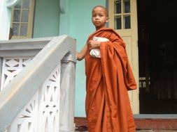 A little Buddhist with a pensive look