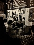 black and white photo of people in the tavern