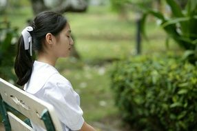 asian girl sitting on the bench