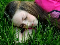 girl is sleeping on the grass