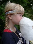 Girl is eating cotton candy