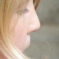 blond child girl face close up, profile