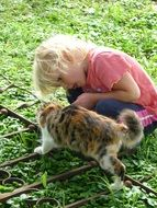 small girl and nice cat