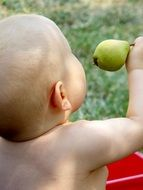 little baby with green fruit