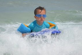 child in waves