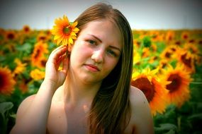girl with a sunflower in her hair