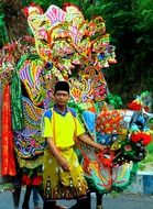 man with carnival decoration, indonesia, java, lumajang