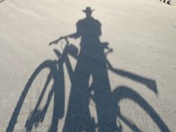 shadow of a man with a bicycle