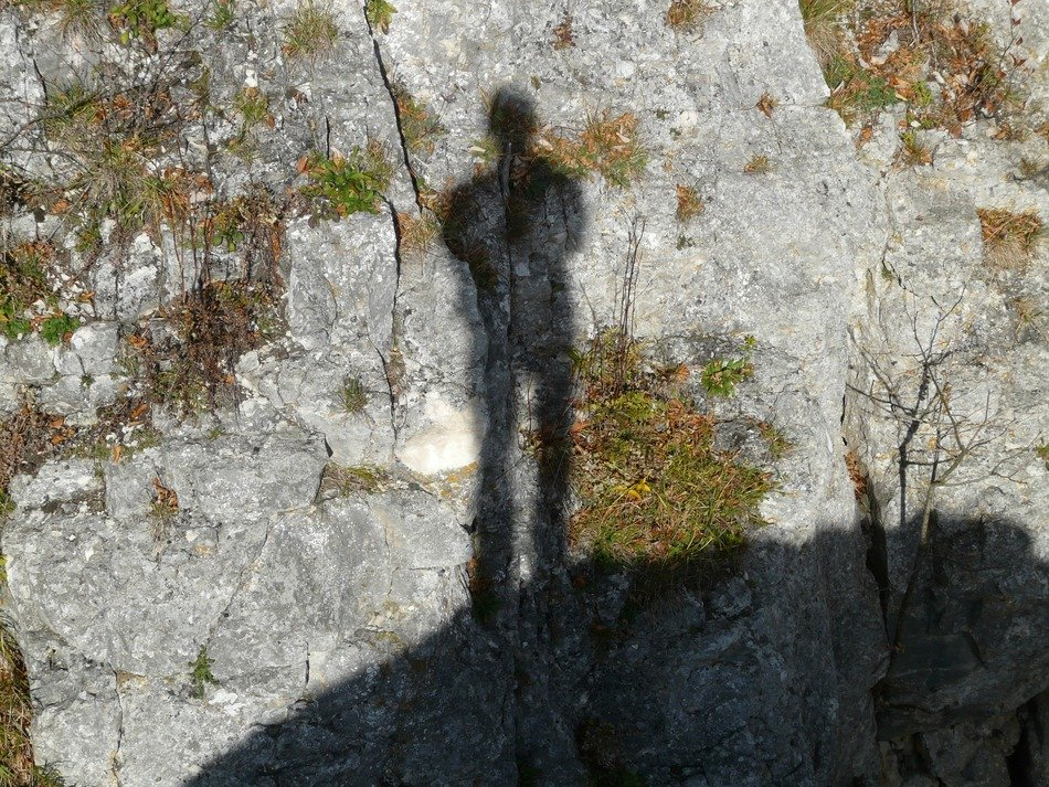 Shadow of a man on a stone wall