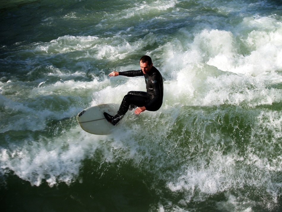 Top view of the surfer on the waves