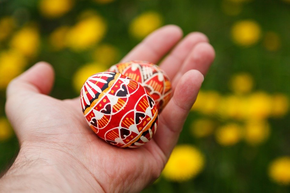 two painted eggs lie in hand