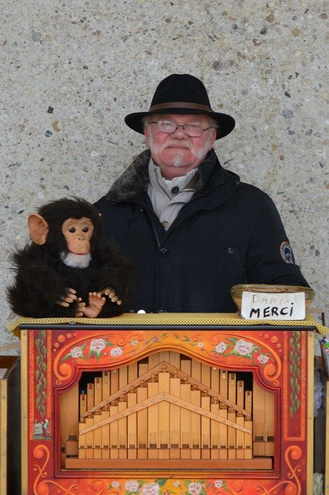 Old man with a monkey at the organ