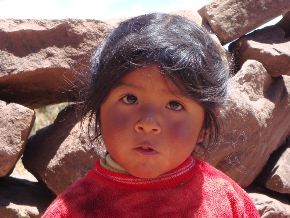 The face of the child on the background of stones, peru