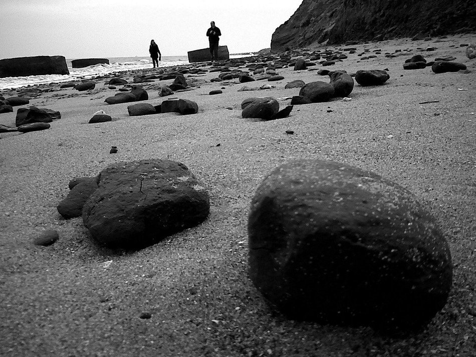 beach with large stones in black and white background
