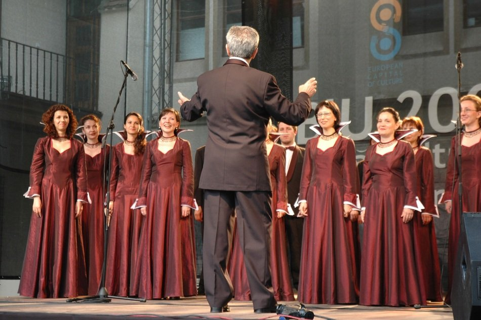 Female choir and conductor on stage
