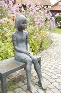 sculpture of a sitting girl