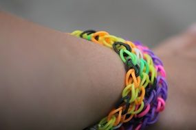bracelet of colored rubber bands on the arm