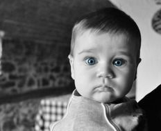 portrait of a surprised baby in monochrome image