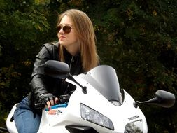 blonde girl on motorcycle wearing leather jacket