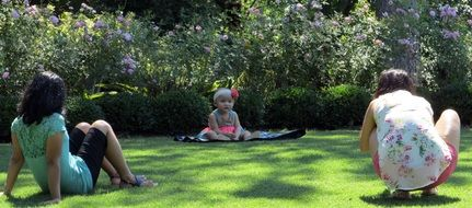 photo shoot of a child on a green lawn