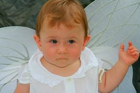 child with angel wings