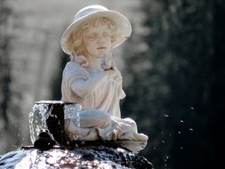 sculpture of a girl on the fountain