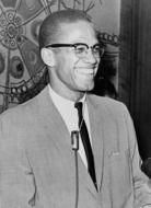black and white photo of african american with microphone