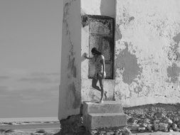 abstract girl posing at old wall, black and white