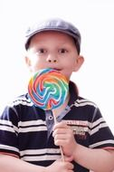 child with big lollypops