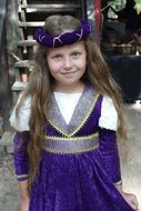 nice child girl in lilac renaissance costume