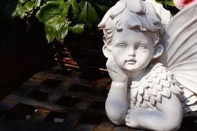 white stone statue of an angel