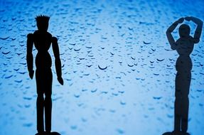 men silhouettes on the blue background
