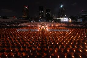 buddhists monks ceremony with lights