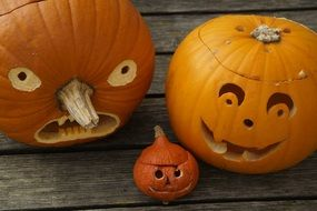 three pumpkins as attributes for halloween