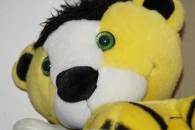 yellow and white soft tiger toy