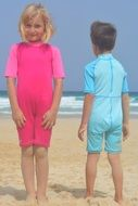 contrast blue boy and pink girl on beach