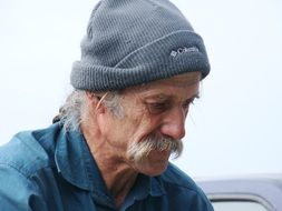 fisherman in a gray hat