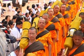 buddhists monks In orange robes walking