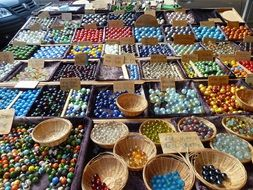 colorful glass marbles on the market
