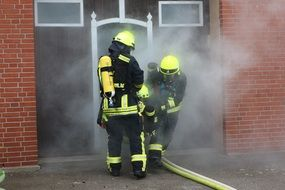 two specialists extinguish a fire