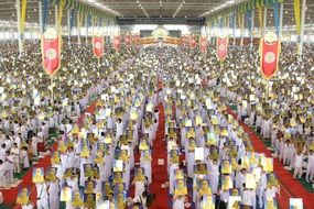 buddhists crowd meditating ceremony