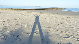 shadow man in sand