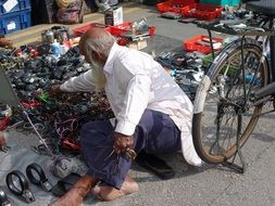 man selling spare parts at flea market