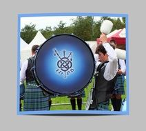 Scotsman plays on a blue base-drum